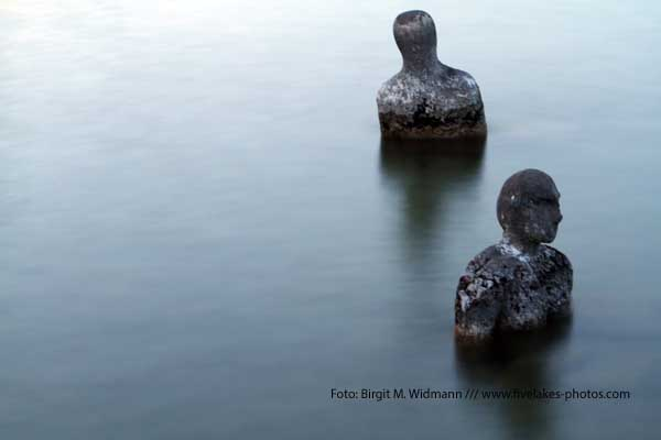 stone figures i lake ammersee germany